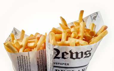 Two newspaper cones of French fries