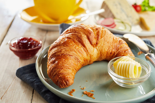 Croissant served on plate with butter