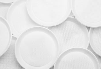 White plastic plates close-up