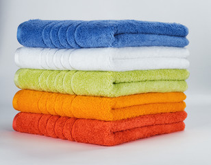 Multicolored towels on a white background
