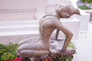 Ancient Twisted Hermit alloy statue depicts Indian yoga pose (traditional medicine and stretching movement knowledge), helping maintain health, vitality and reduce stress in Wat Pho, Bangkok, Thailand