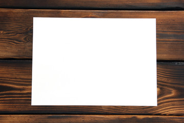 Paper. Paper on wooden background. Isolated with plenty of room for your text.