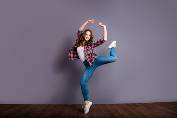 Wall Mural - Full length size body view photo of fly high attractive beautiful she her lady pretending like ballet dance queen wearing casual jeans denim checkered plaid shirt on grey background