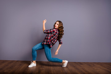 Wall Mural - Full length size body view photo fly high amazing attractive beautiful she her lady modern crazy dance like flight up in air wearing casual jeans denim checkered plaid shirt grey background