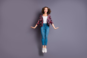 Wall Mural - Full length size body view photo jumping high amazing attractive beautiful she her lady flight up in air pretty cute wearing casual jeans denim checkered plaid shirt grey background