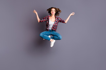 Full length size body view photo jumping high amazing attractive she her lady lotus pose dreamy dream inspired imagination wearing casual jeans denim checkered plaid shirt grey background
