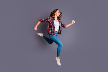 Full length size body photo of fly high attractive beautiful she her girl want to be in time for black friday sale discount wearing casual checkered plaid shirt jeans denim isolated grey background