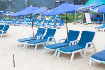 Beach summer holiday with chair and umbrella