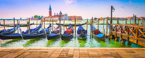 Moored gondolas on Grand Canal in Venice.