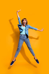 Wall Mural - Full length body size photo jumping flight high amazing beautiful she her lady hands arms legs separate win wearing casual jeans denim shirt clothes isolated on yellow background