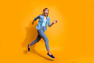 Full length body size photo yelling  jumping high amazing beautiful she her lady little low prices rushing shopping mall store wearing casual jeans denim shirt clothes isolated on yellow background