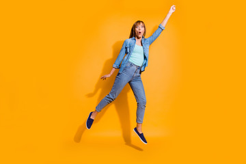 Wall Mural - Full length body size photo yelling  in flight jumping high beautiful she lady not believe umbrella take her in sky wearing casual jeans denim shirt clothes isolated on yellow background