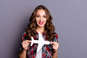 Wall Mural - Close-up portrait of her she nice-looking cute attractive lovely charming glamorous cheerful wavy-haired lady holding in hands white plane form figure shape way direction isolated over gray background
