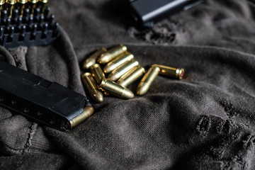 FMJ 9mm automatic pistol ballistic on cloth background