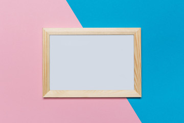 blank frame on a blue and pink background