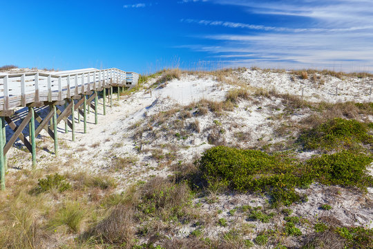 Boardwalk and sand dunes near the beach at Anastasia State Park near St. Augustine Beach, Florida