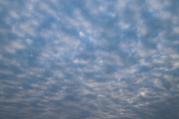 Scenery of dark cloudy blue sky in the evening. The natural art background and template.