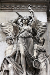 Architectural details of Opera National de Paris: Lyrical Drama Facade sculpture by Perraud. Grand Opera (Garnier Palace) is famous neo-baroque building in Paris, France - UNESCO World Heritage Site.