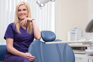 Young beautiful blond woman dentist at dentist's surgery