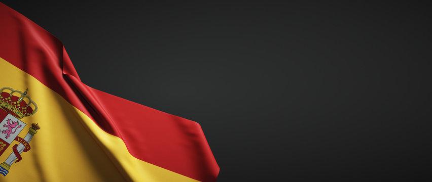 Bandera de España con escudo de tela sobre fondo oscuro