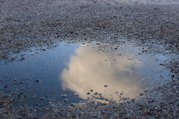 Cloud in puddle reflection gravel