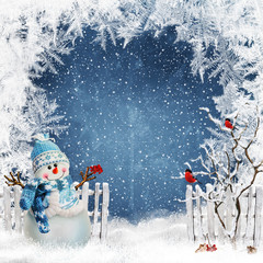 Christmas greeting background with a snowman near the fence and bullfinches on the branches of a tree
