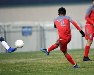 High School boy athletes making amazing plays during a soccer game