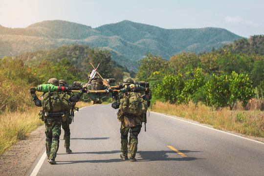 The transport of wounded soldiers to heal.Soldiers are carrying their wounded soldiers on the battlefield to safe places for medical treatment