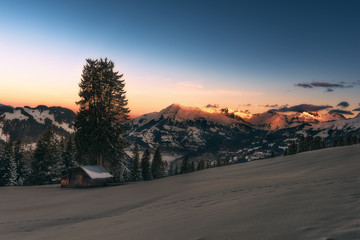 Winterly alpenglow at sunrise