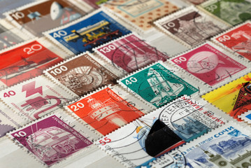 Kiev, Ukraine, February 04, 2019: Postage stamps of Germany of the twentieth century on Technical topics. Shallow depth of field