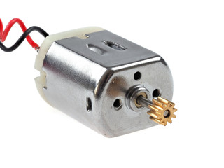 Small size direct current motor, with red and black wires, isolated on white. The kind of motor used in many electronics and student projects.