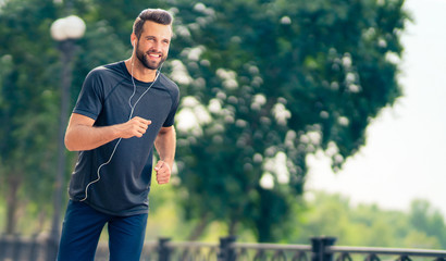 Happy man during morning jogging, outdoors
