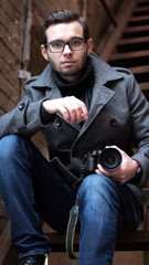 Portrait of a young promising guy photographer closeup