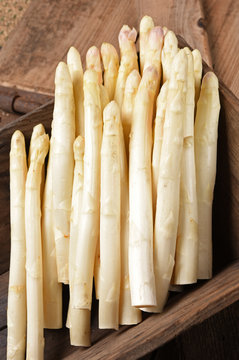 white asparagus on old table