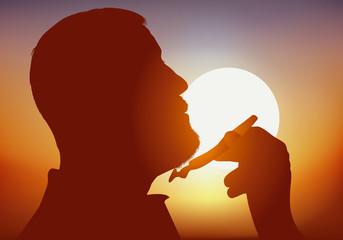 Concept du geste quotidien avec un homme de profil qui se rase avec un rasoir mécanique, au lever du jour.