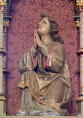 Angel statue on the altar in the church of Saint Matthew in Stitar, Croatia