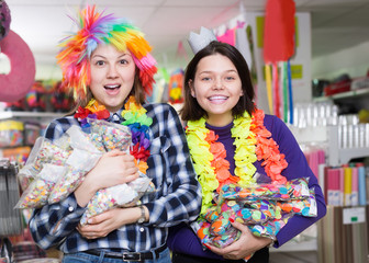 girls with bagfuls of multicolored confetti