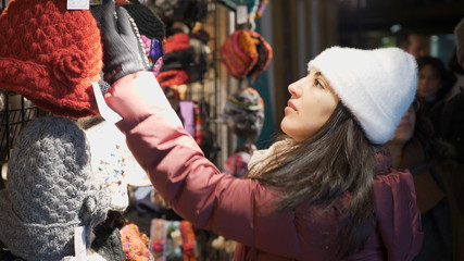 Young woman looks for presents on a Christmas market