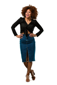 full body afro woman placing hand on hips