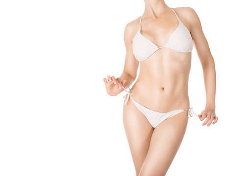 Sexy fit woman in white classic bikini, isolated on white