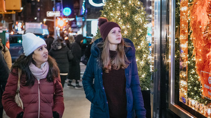 Young women in New York doing Christmas shopping on Fifth Avenue