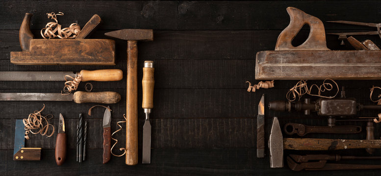 Old woodworking tools on wooden workbench