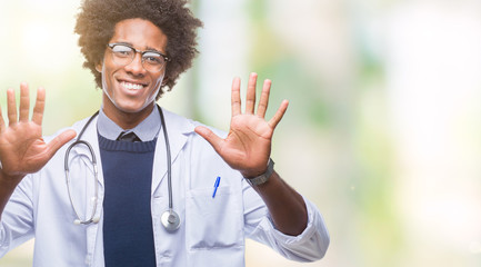 Afro american doctor man over isolated background showing and pointing up with fingers number ten while smiling confident and happy.