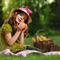 girl with fruit in park picnic