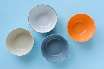 Assorted empty clean bowls and plates on blue