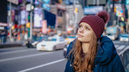Young beautiful woman in the streets of New York for sightseeing