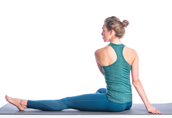 Athletic young blonde woman doing yoga practice isolated on white background. Concept of sport - healthy life and natural balance between body and spiritual development