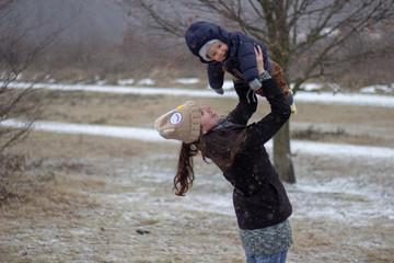 mother holds babyboy