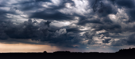 Panoramic image of storm clouds with asperitas clouds