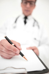 background image.the doctor signing the medical report.